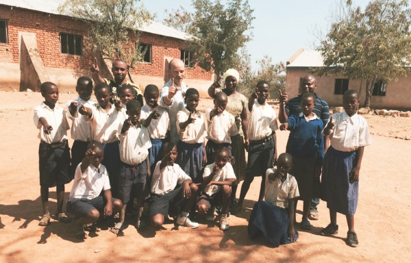 ONE co-founder Jamie Drummond with pupils at school who will be 15 in 2015. Photo: ONE
